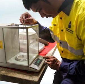 Technician-calibrating-balance-scale